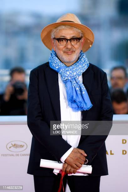 Palestinian film director and actor Elia Suleiman poses during a photocall after he won on May 25 2019 the Special Jury Prize for his film It Must Be...