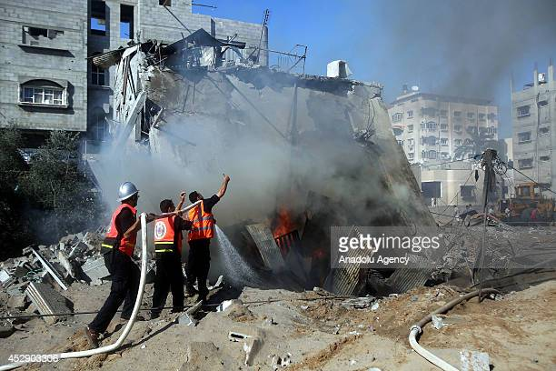 Palestinian fire crews fire extinguishing after Israeli airstrike hits a building belongs to Palestinian Abdulgafur family in Khan Yunis Gaza on July...