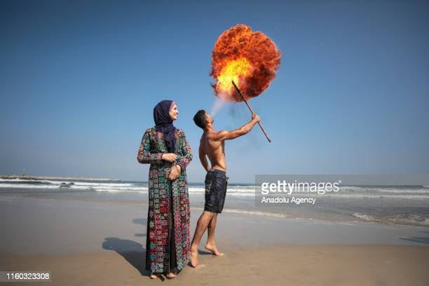 Palestinian fire spitting artist performs fire show at the beach of Gaza shore in Gaza City Gaza on August 08 2019