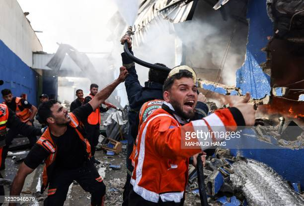 Palestinian firefighters douse a huge fire at the Foamco mattress factory east of Jabalia in the northern Gaza Strip, on May 17, 2021.