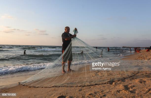 Palestinian fisherman Jihad alSoltan is seen after he found a letter in a bottle off a Gaza beach containing a message which was written and thrown...