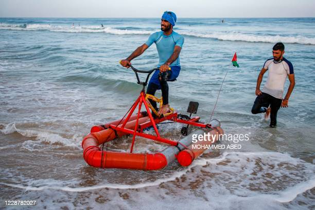 Palestinian fisherman tests along the seashore a custom-built pedal boat made from recycled materials at a beach by Beit Lahia in the northern Gaza...
