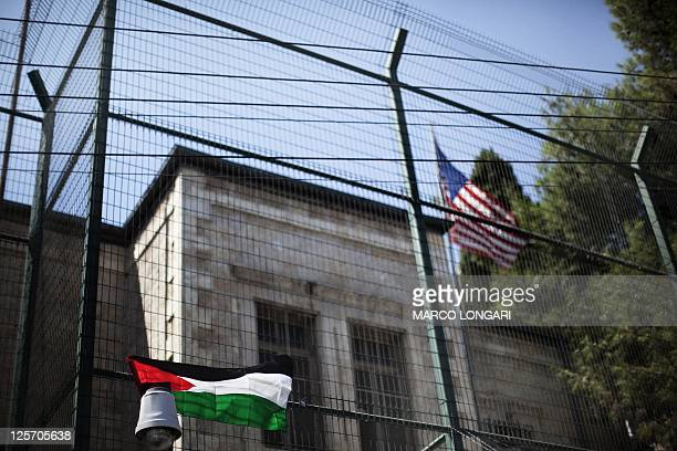 A Palestinian flag hangs on the fence of the US General Consulate in east Jerusalem during a protest against US' interference in the Palestinian bid...
