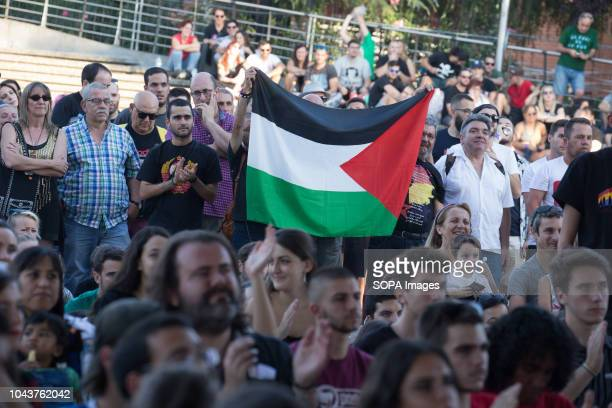 Palestinian flag seen among the public during the tour with Ahed Tamimi Ahed Tamimi on her European tour during the Spanish Communist festivities...