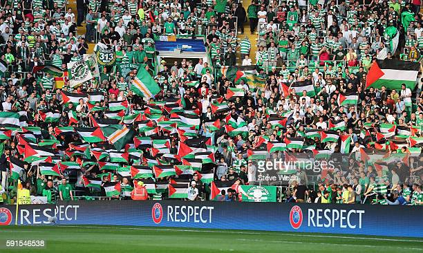 Palestinian flags are waved by fans during the UEFA Champions League Playoff First leg match between Celtic and Hapoel BeerSheva at Celtic Park on...