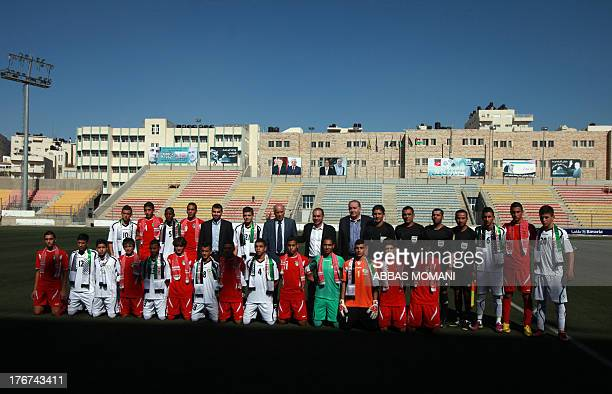 Palestinian Football Association chairman Jibril Rajoub and FIFA VicePresident Prince Ali bin alHussein from Jordan pose for a picture with players...