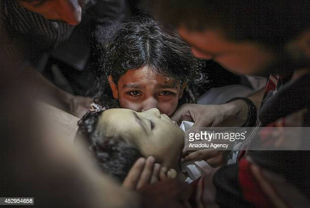 Palestinian girl Ansam says goodbye to her little brother Sameh Junaid, killed in an Israeli cannon shot within the 'Operation Protective Edge'...