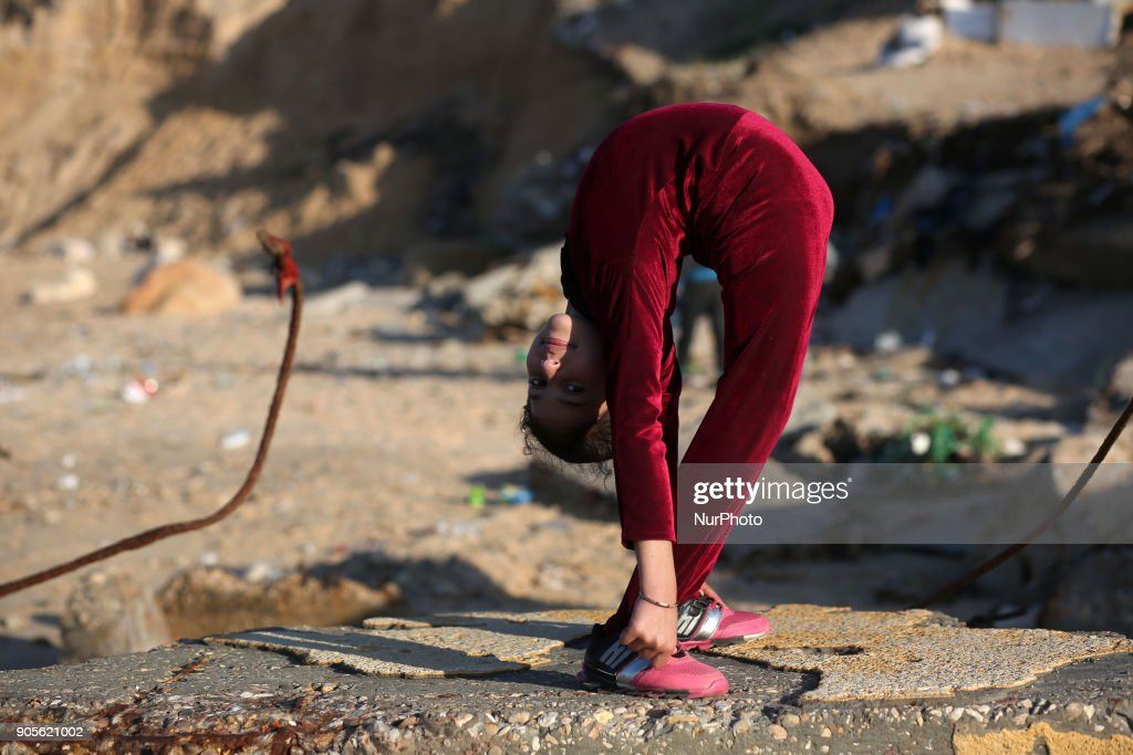 A Palestinian girl demonstrates acrobatics skills in Gaza