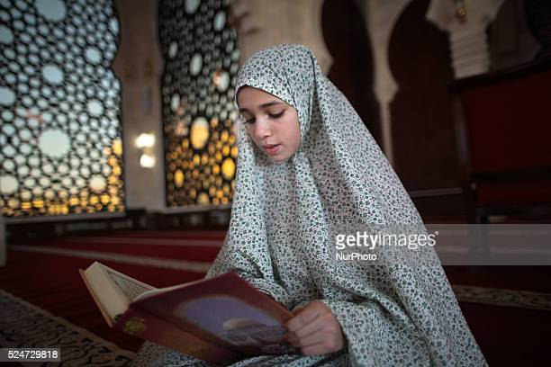 A palestinian girl Asmaa Ouda reads Quran at alkhaldi mosque on the Muslim fasting month of Ramadan in Gaza City Ramadan is the holiest month in the...