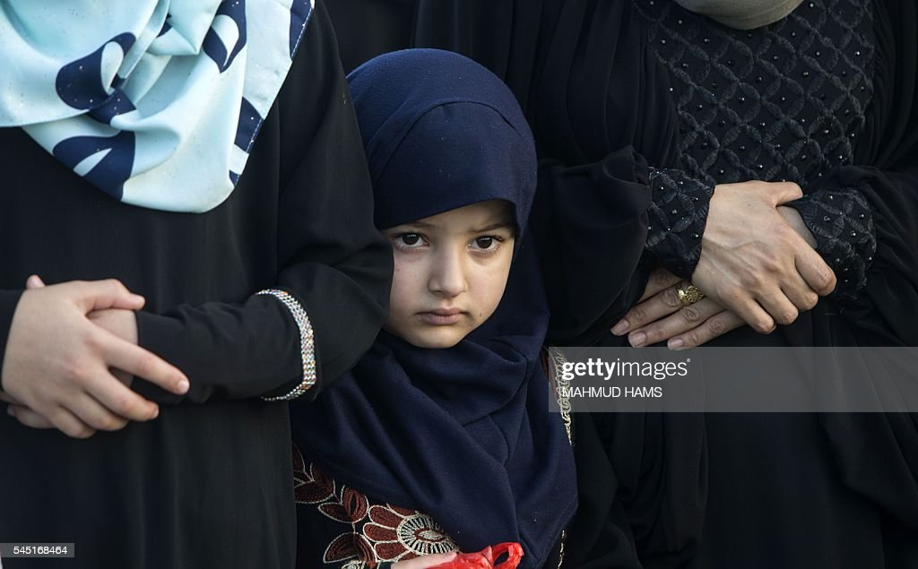 Wonderful Gaza Eid Al-Fitr 2018 - palestinian-girl-attends-the-morning-eid-alfitr-prayers-in-gaza-city-picture-id545168464  Graphic_177862 .com/photos/palestinian-girl-attends-the-morning-eid-alfitr-prayers-in-gaza-city-picture-id545168464