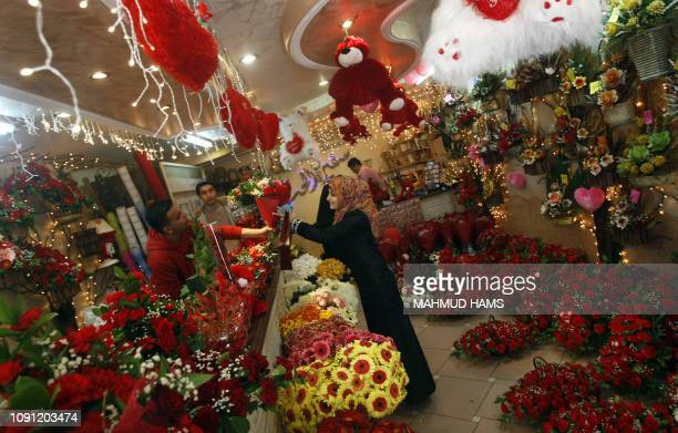 A Palestinian girl buys flowers for Valentine's day at a shop in Gaza City on February 14 2009 Despite the devastation of Israel's 22day offensive...
