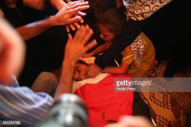Palestinian girl cry after she saw the bodies of two Palestinian brothers Omar and Mohammed Braim who were killed yesterday, before the open-ended...