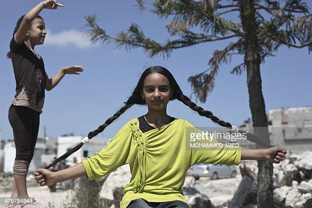 A Palestinian girl displays her hair during a demonstration to denounce the 50day war between Israel and Hamas' militants in the summer of 2014 on...