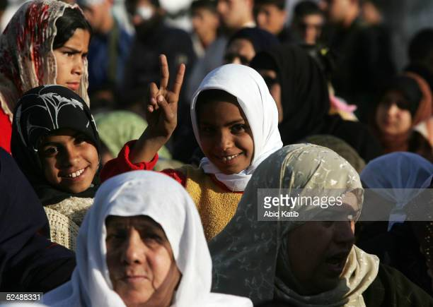 Palestinian girl flashes a V sign as she participates in a proelection rally organized by the Fatah movement March 28 2005 in the Beit Lahyea Refugee...