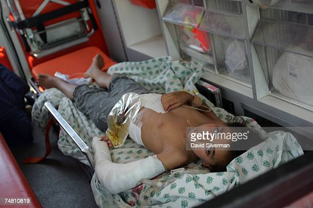 Palestinian girl from the Gaza Strip with gunshot wounds to her arm and abdomen lies in an Israeli ambulance as she is evacuated to an Israeli...