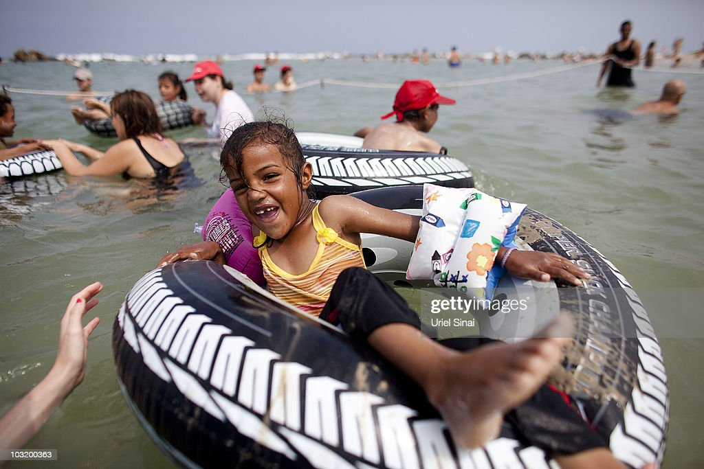A Palestinian girl from the West Bank village of Jahalin plays in the water as she enjoys a day at the beach on August 2, 2010 in Bat Yam, Israel. A group of Israeli women organize a weekly visit for Palestinian children from all over the West Bank to the the Israeli seaside, for most of the children this is the first time they get to the beach.