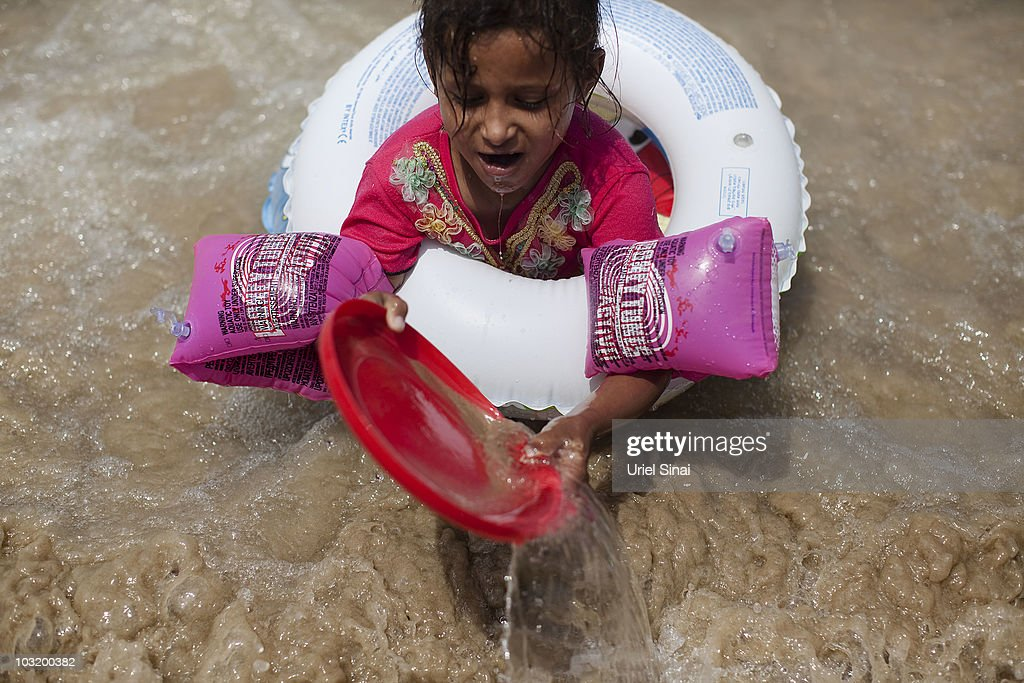 A Palestinian girl from the West Bank village of Jahalin spends the day at the beach on August 2, 2010 in Bat Yam, Israel. A group of Israeli women organize a weekly visit for Palestinian children from all over the West Bank to the the Israeli seaside, for most of the children this is the first time they get to the beach.