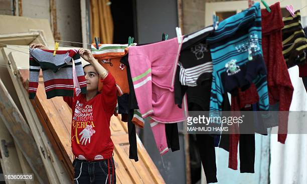 A Palestinian girl hangs the laundry outside her home in the Mediterranean beachfront alShati Palestinian refugee camp the third largest in the...