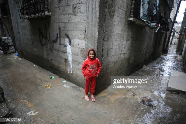 Palestinian girl is seen on a street under difficult conditions at Jabalia refugee camp, in Gaza City, Gaza on December 17, 2020. The number of...