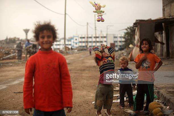 Palestinian girl play next to a destroyed building in the town of Beit Hanoun the northern Gaza Strip Sunday Oct 20 2014