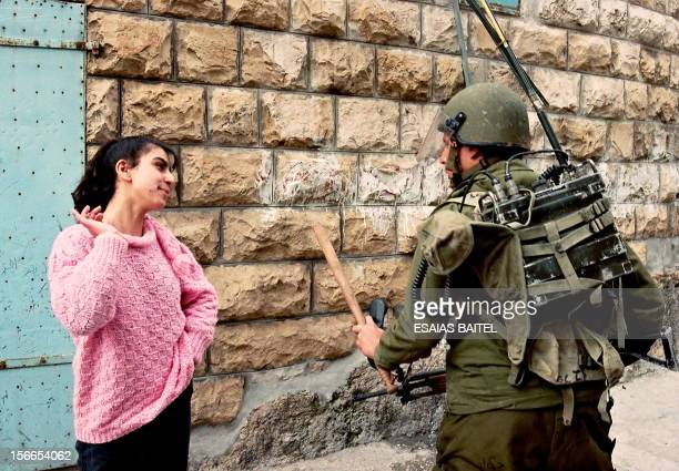 A Palestinian girl provokes an Israeli soldier 28 February 1988 in Bet Sahur after the Israeli army had entered the village near Bethlehem following...