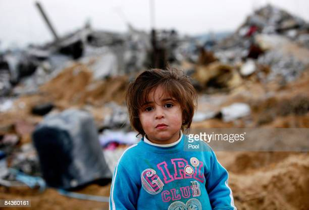 Palestinian girl stands amongst the ruins of houses destroyed by Israeli airstrikes on January 19, 2009 on the outskirts of Jabalya, Gaza Strip....