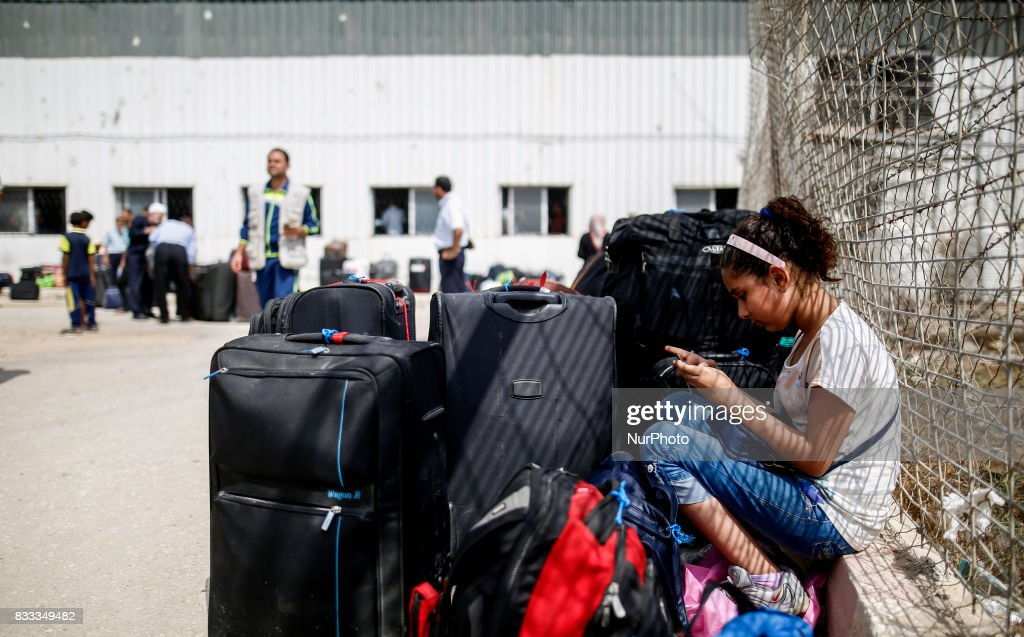 A Palestinian girl waits to cross the Rafah Border crossing , in Rafah in the southern Gaza Strip, on August 16, 2017.