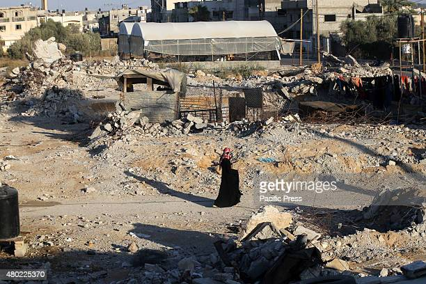 Palestinian girl walks between the rubble of houses destroyed during the 50day war between Israel and Hamas militants in the summer of 2014 in the...