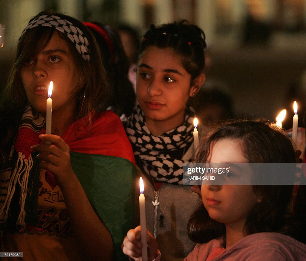 Palestinian girls hold up candles during a sit-in in the Gulf emirate of Sharjah 23 January 2008, against the Israeli blockade of the Gaza Strip. The tiny coastal strip was sealed off 17 January when Israel closed all crossing points into the territory in response to persistent rocket attacks by Palestinian militants.