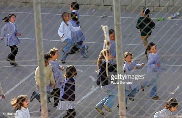 Palestinian girls play during a break at the UN sponsored school inside the Aida refugee camp March 23 2006 in Bethlehem West Bank The controversial...