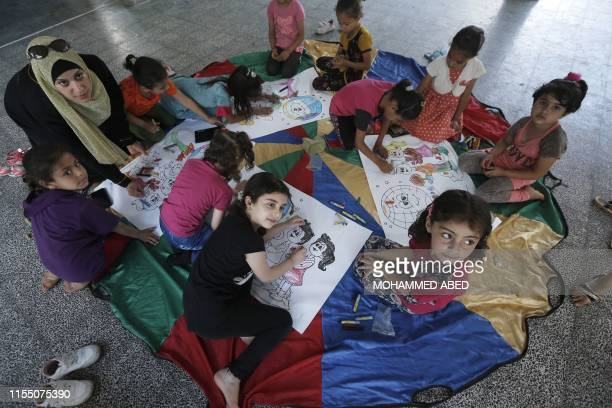 Palestinian girls play during an activity at a summer camp organised by the United Nations Relief and Works Agency in Gaza City on July 11 2019