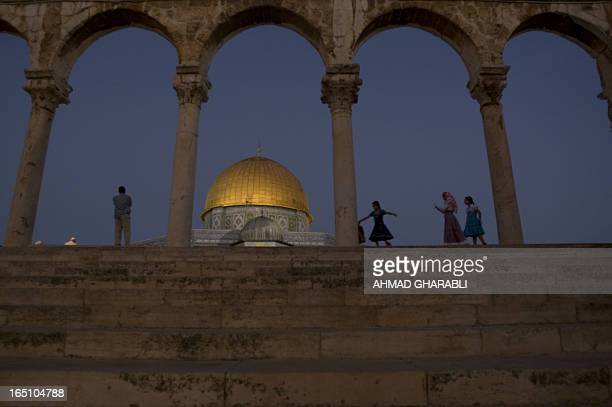 Palestinian girls play outside the Dome of Rock at the AlAqsa Mosque compound in Jerusalem's Old City on September 10 2010 following the Eid AlFitr...
