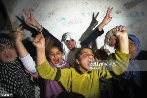 Palestinian girls shout anti-Israeli slogans as they celebrate in Jabalya refugee camp in Gaza Strip March 14 after two Palestinian suicide bomber...