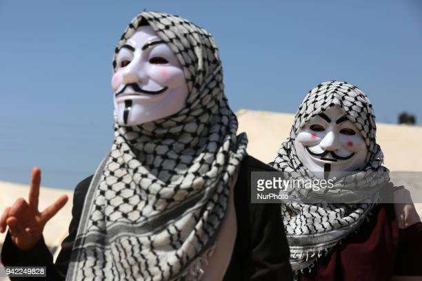 Palestinian girls wearing a Guy Fawkes mask in east of Gaza near the roundabout Malka on April 4 2018