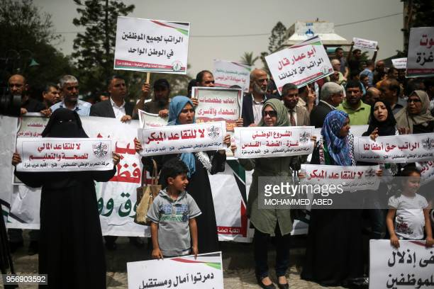 Palestinian government employees under the Palestinian Authority demonstrate in Gaza City on May 10 2018 against deductions in their salaries and the...