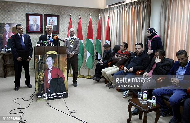 Palestinian governor of Hebron Kamel Hamid speaks next to doctor Rayan alAli who carried out the autopsy of 21yearold Palestinian Abdul Fatah...
