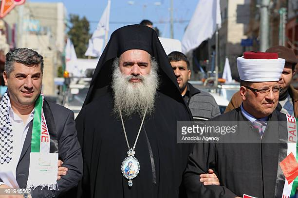 Palestinian Greek Orthodox Archbishop Theodosios Hanna attends a rally staged by a group of Palestinians in Hebron on January 22 2015 against...