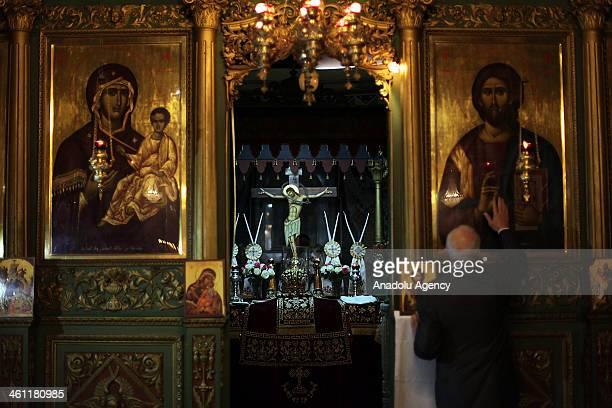 Palestinian Greek Orthodox Christians attend Christmas mass at the Orthodox Saint Porfirios church in Gaza City on January 7 2014 The Orthodox Church...