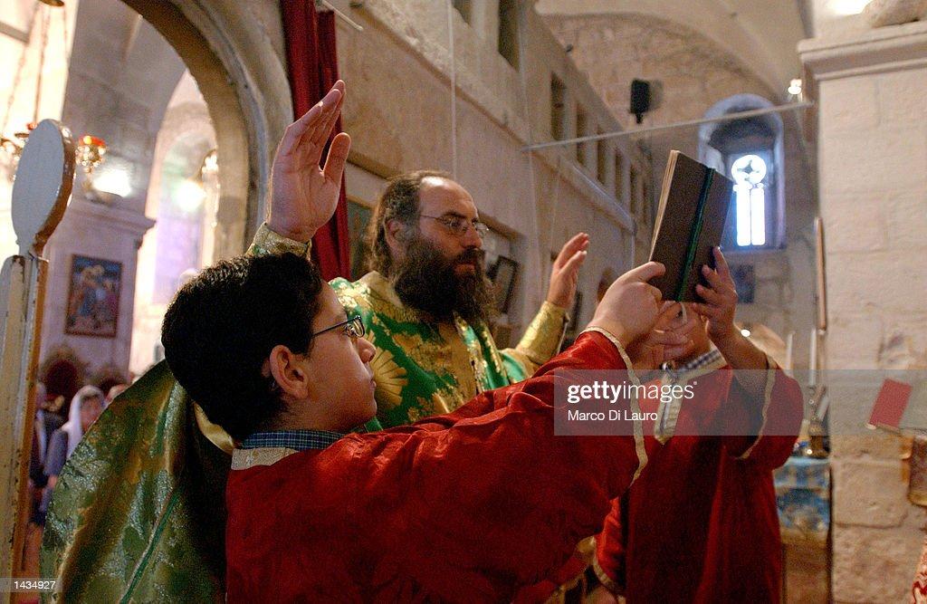 A Palestinian Greek Orthodox priest celebrates Friday mass