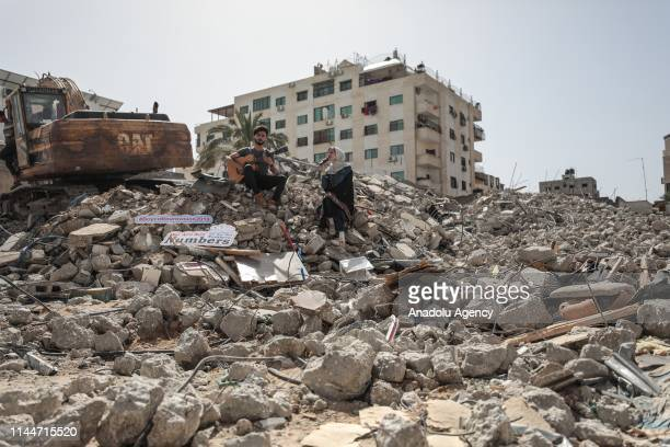 Palestinian group calling themselves 'We are not numbers' perform above a building housing Anadolu Agencys Gaza City office which was destroyed by...