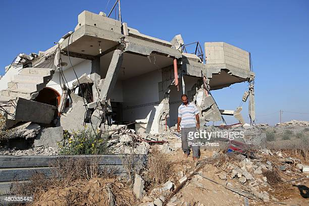 Palestinian Hamada Qudeh, inspecting their house which was destroyed during the 50-day Israeli war against Gaza in the summer of 2014, in the village...