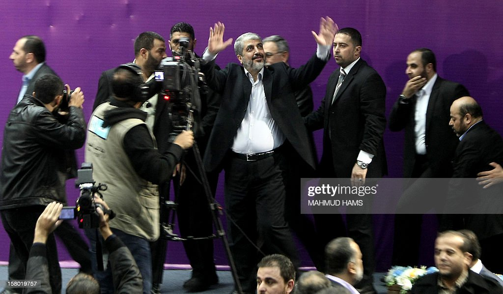 Palestinian Hamas chief in exile Khaled Meshaal (C) waves at supporters during a visit to the Islamic University in Gaza City on December 9, 2012. Meshaal rejected ceding 'an inch' of Palestinian territory to Israel or recognising the Jewish state, in a speech in Gaza where he is on a historic first visit.
