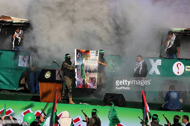 Palestinian Hamas militants march in front of a mock burnt Israeli bus during an antiIsrael rally in Gaza city April 28 2016