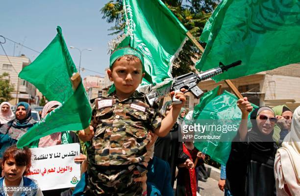 Palestinian Hamas movement supporters march in the city of Hebron in the Israelioccupied West Bank on July 28 as protests erupt in support of the...