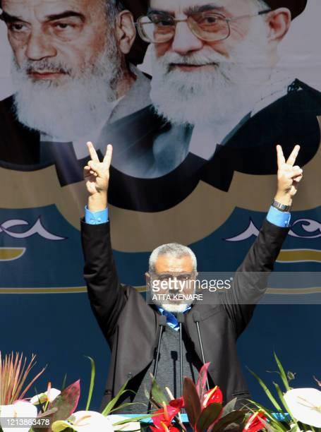 Palestinian Hamas premier of Gaza Ismail Haniya flashes victory signs under portraits of Iran's late founder of Islamic Republic Ayatollah Ruhollah...