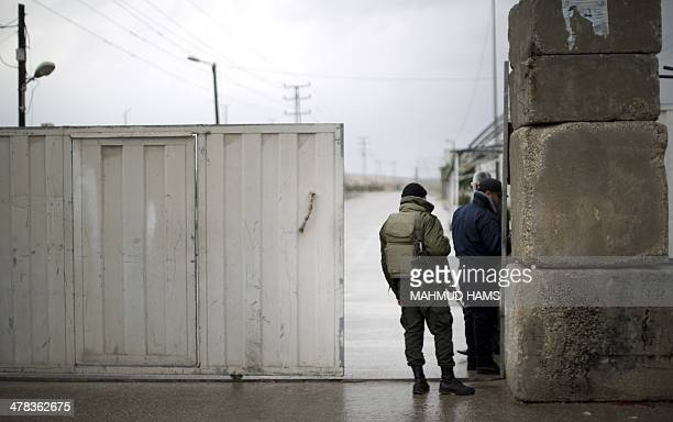 Palestinian Hamas security forces stand at the Palestinian side of the Erez pedestrian crossing with Israel after the terminal was closed on March 13...