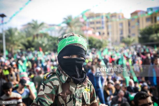 Palestinian Hamas supporters attend a rally marking the 30th anniversary of the founding of the Hamas movement 30th anniversary of the founding of...