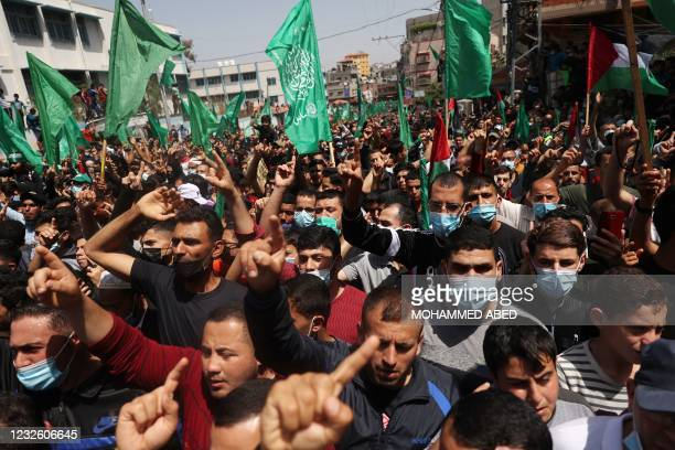 Palestinian Hamas supporters demonstrate in Jabalia in the northern Gaza Strip on April 30 following the postponement of the upcoming Palestinian...