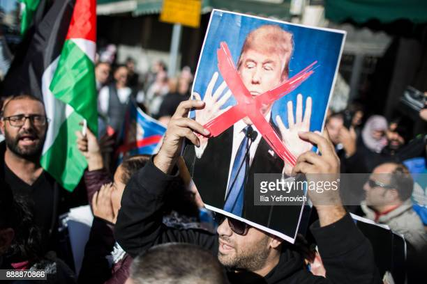 Palestinian hold portrait of Donald Trump during protest on December 9 2017 in Jerusalem Israel Protest in Jerusalem West Bank and Gaza continue into...