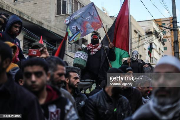 Palestinian holds a Palestinian flag as they gather to protest the U.S.-sponsored draft resolution condemning Palestinian resistance group Hamas in...